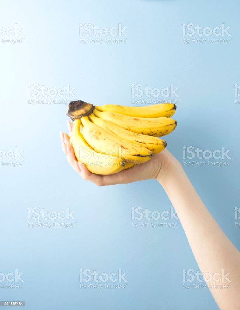 Holding bananas. royalty-free stock photo