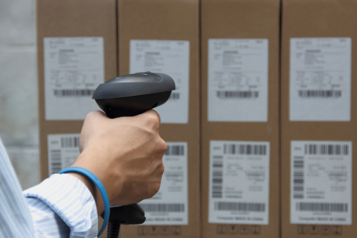 istock Holding barcode scanner with a label on the boxes 467485295