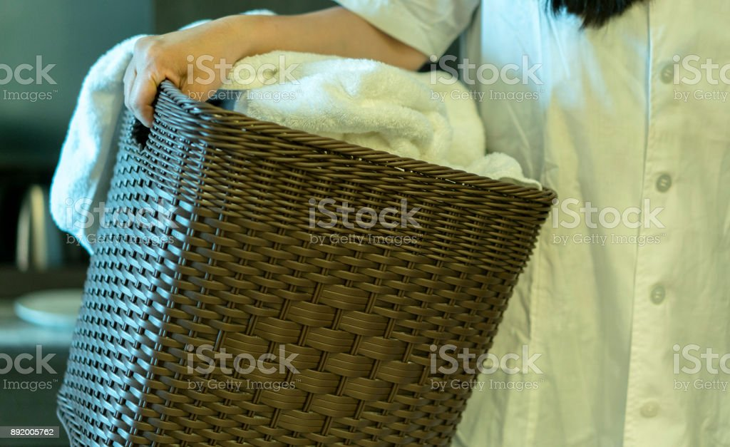 holding bathrobe basket stock photo