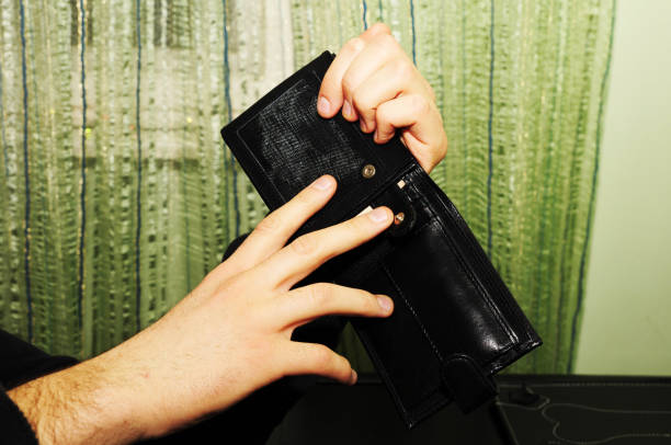 Holding black leather wallet stock photo