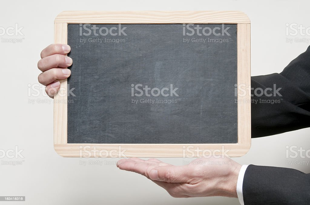 Holding blank board royalty-free stock photo