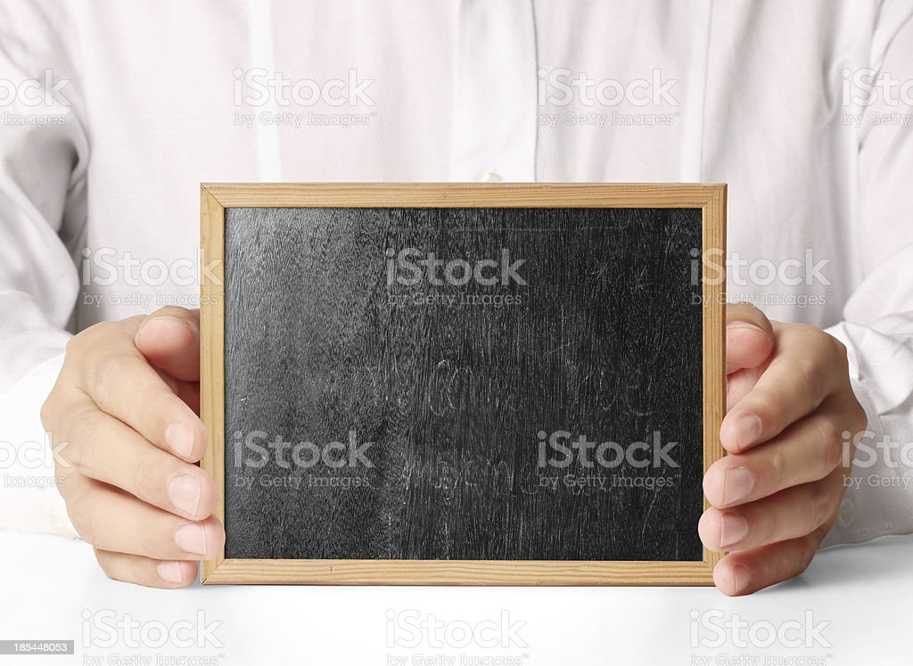 holding blank chalkboard royalty-free stock photo