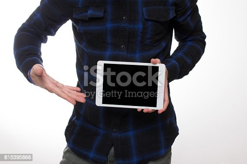 899410700 istock photo holding blank digital tablet with copy space 815395866