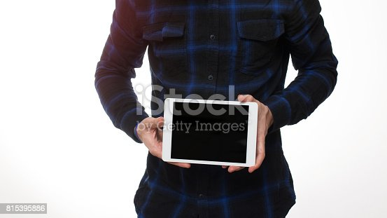 899410700 istock photo holding blank digital tablet with copy space 815395886