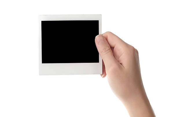 holding blank instant photo stock photo