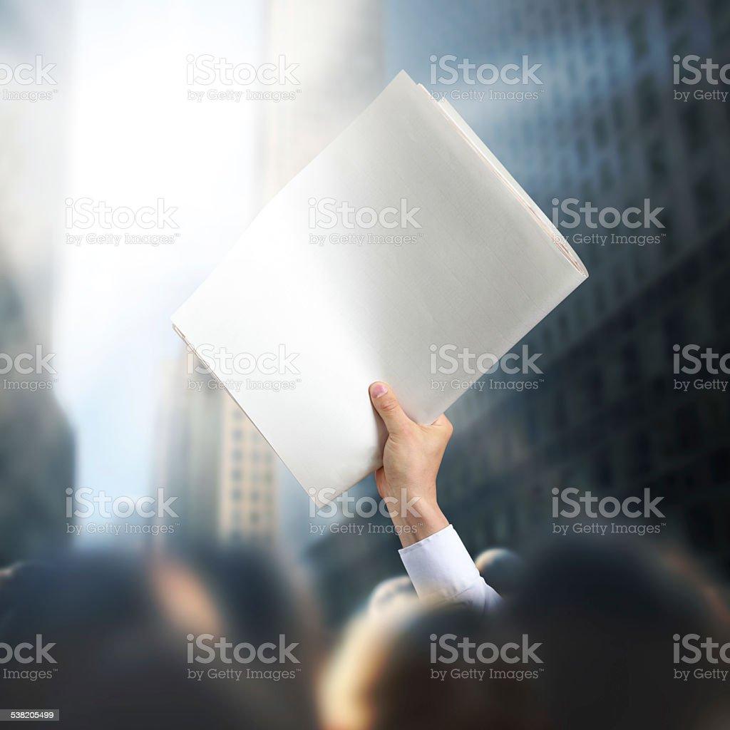 Holding Blank Newspaper stock photo
