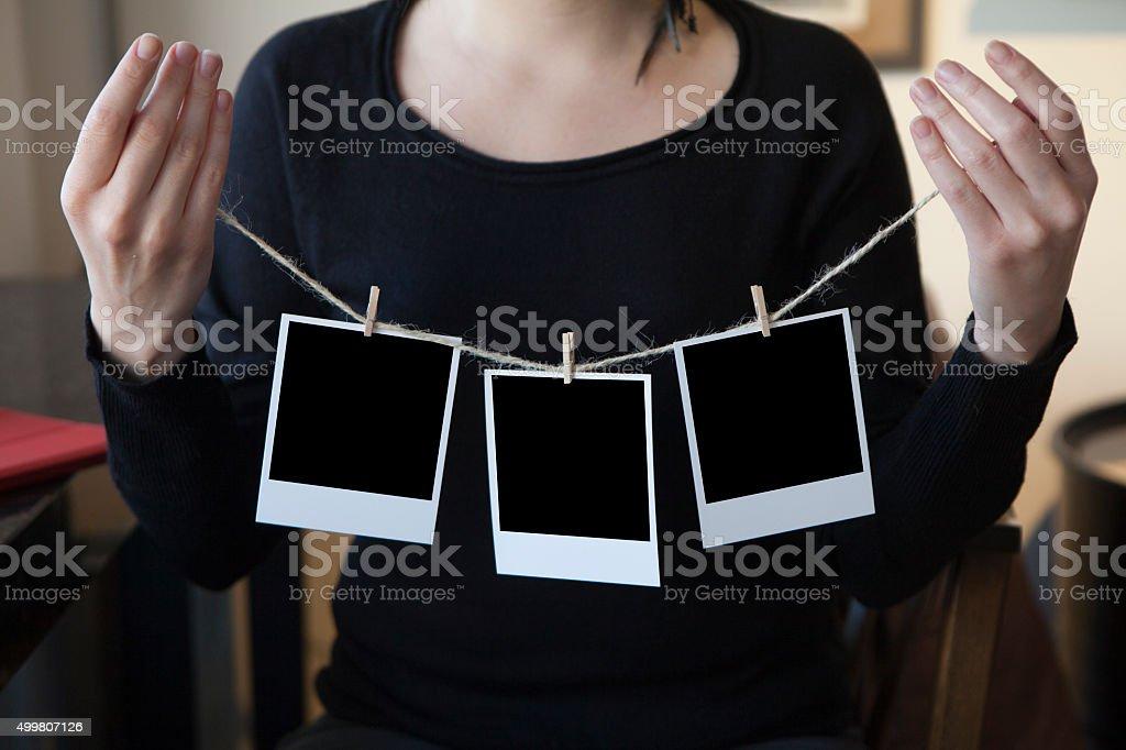 Holding Blank Photo Frame stock photo
