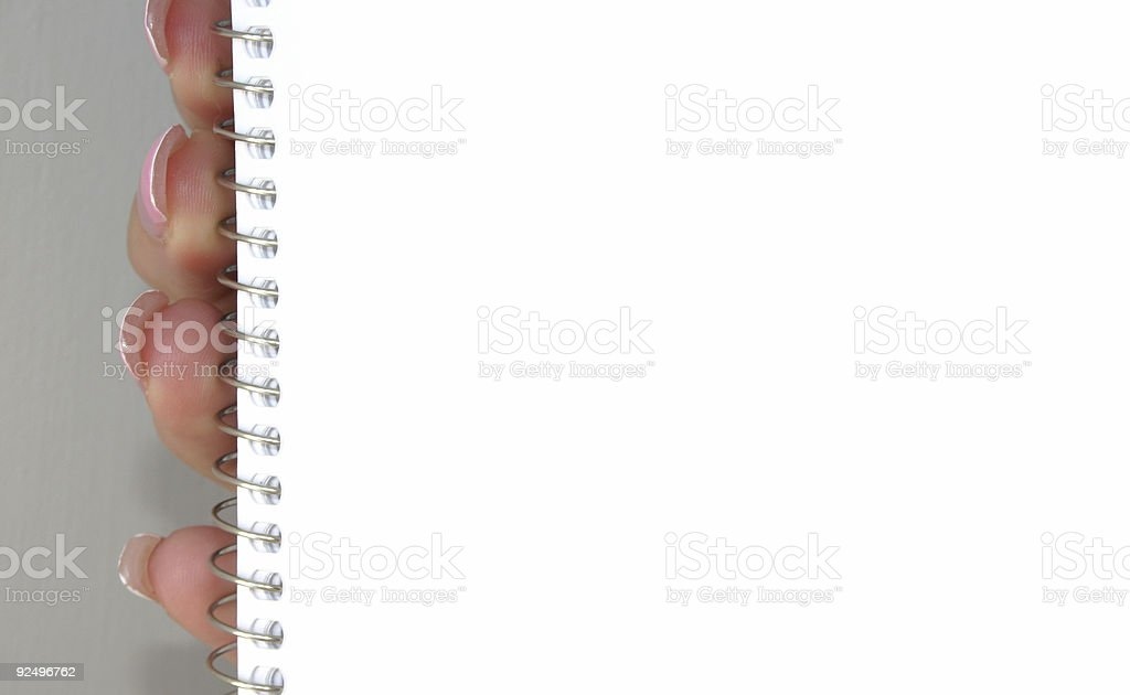 holding blank spiral notebook royalty-free stock photo