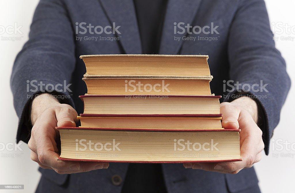 Holding books royalty-free stock photo