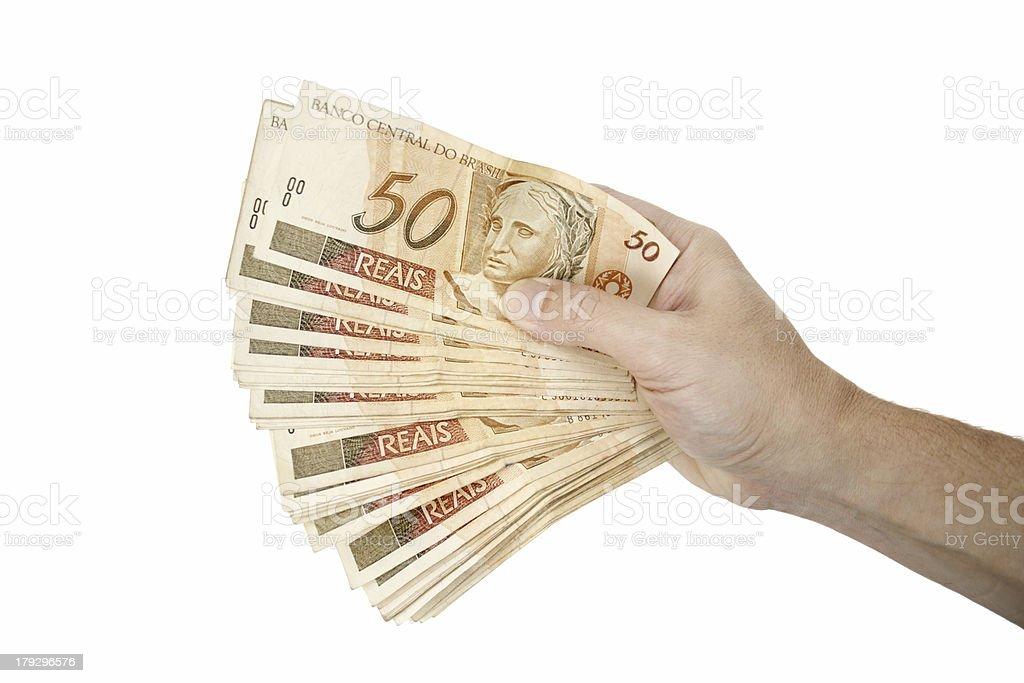 Holding Brazilian money royalty-free stock photo