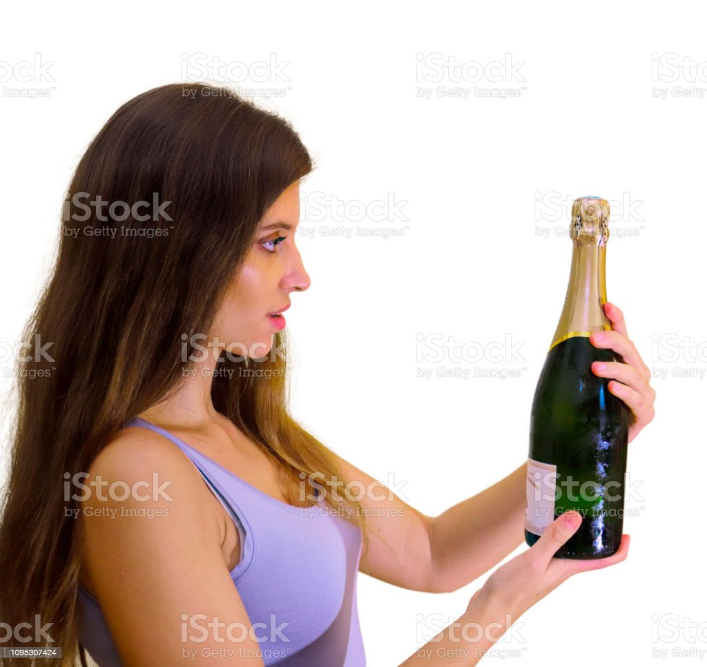 Holding champagne bottle beautiful Russian indoor girl stock photo