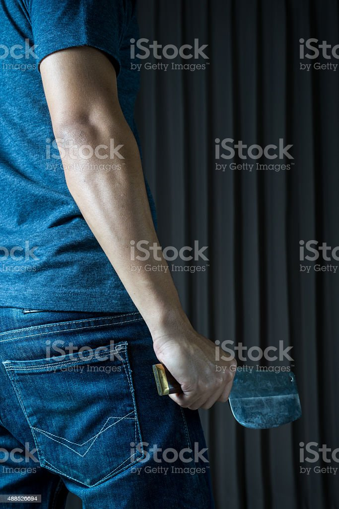 Holding chopping knife in a hand , in dark tone stock photo