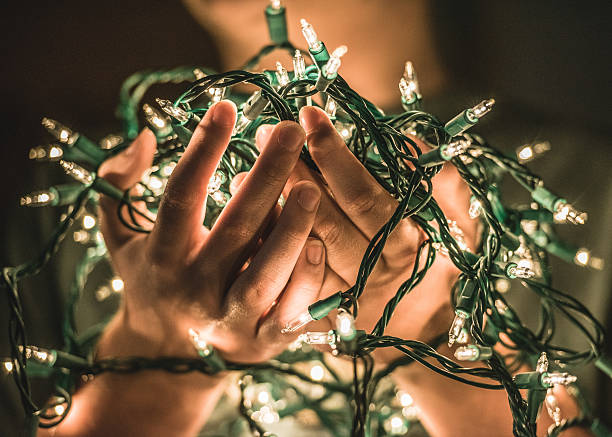 Holding Christmas Light stock photo