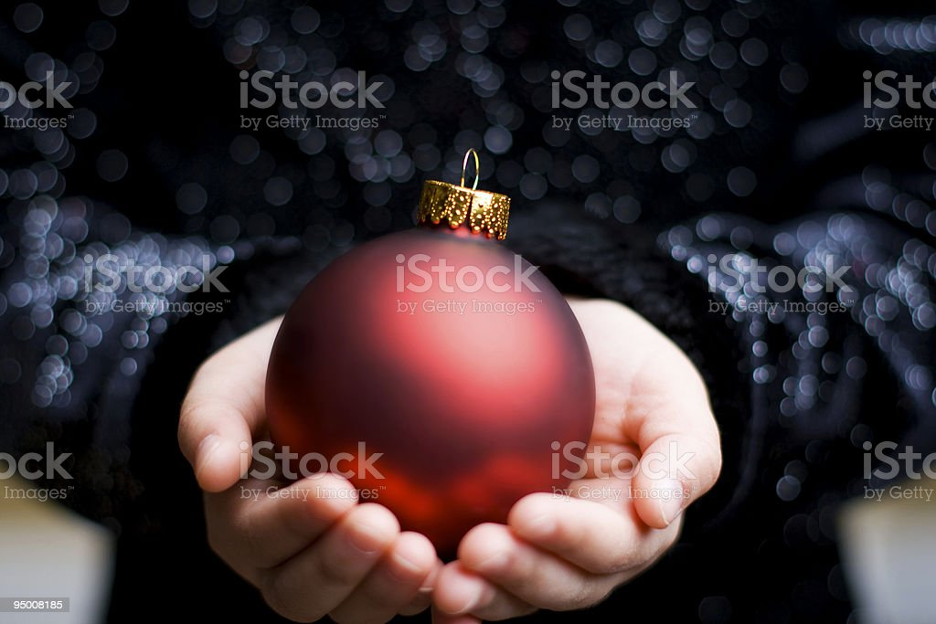 Holding Christmas Ornament royalty-free stock photo