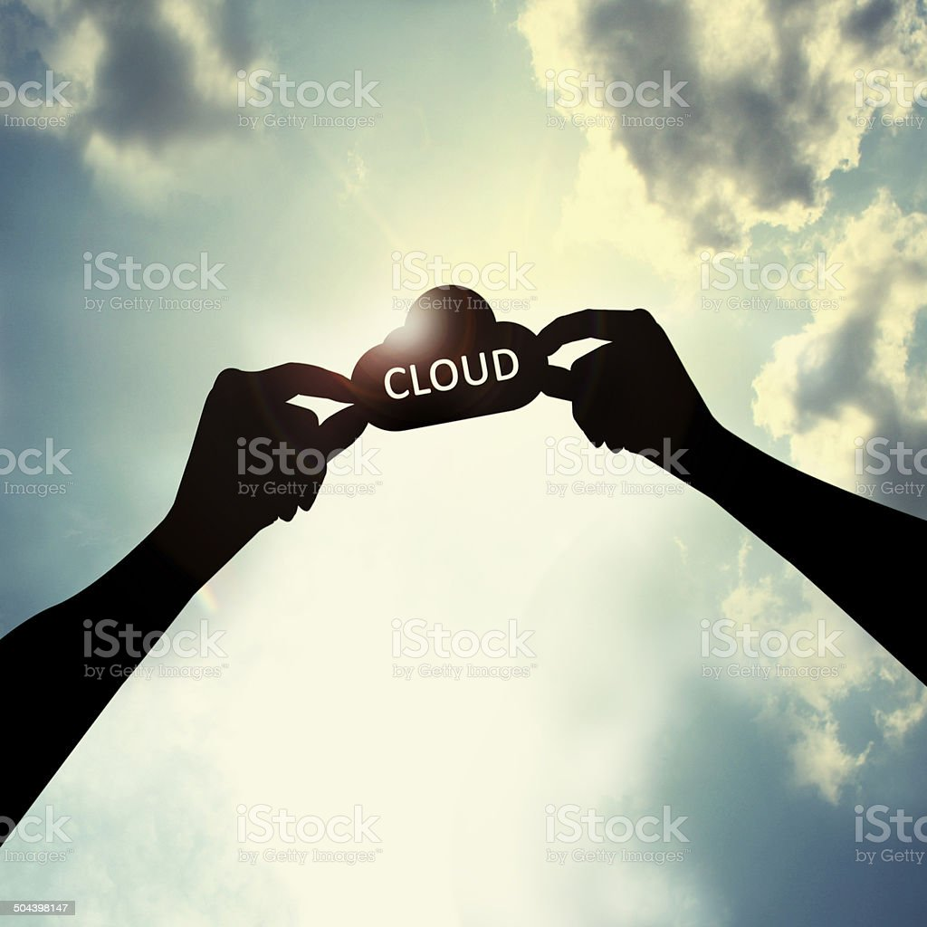 Holding cloud shape in sky stock photo