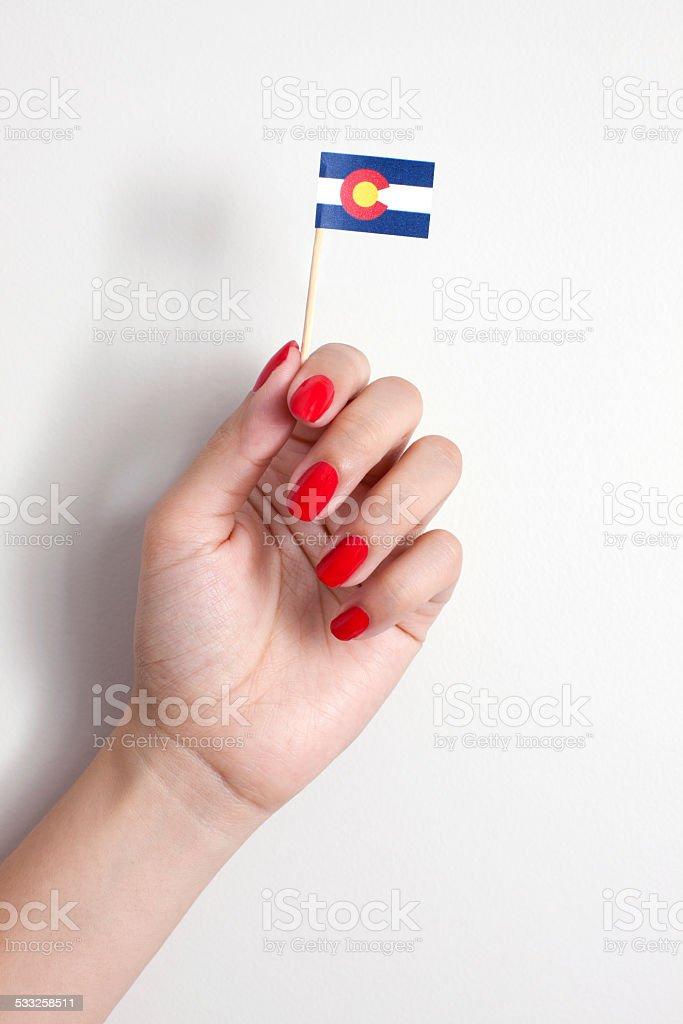 Holding Colorado flag stock photo