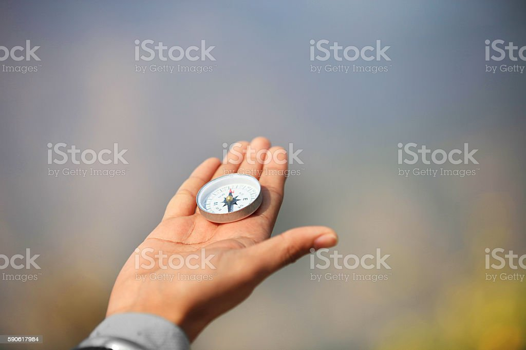 Holding Direction Compass stock photo