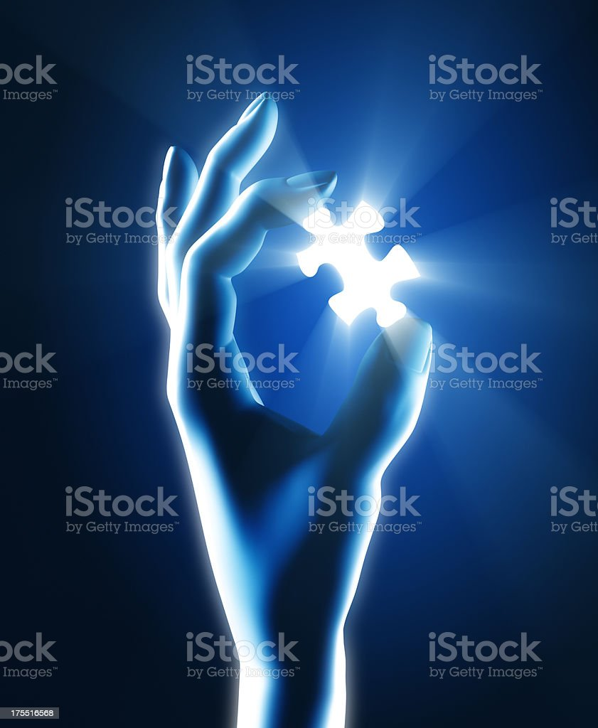 Holding final puzzle piece royalty-free stock photo