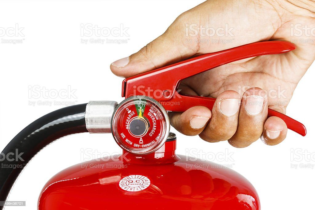 Holding fire extinguisher isolated, with clipping path stock photo
