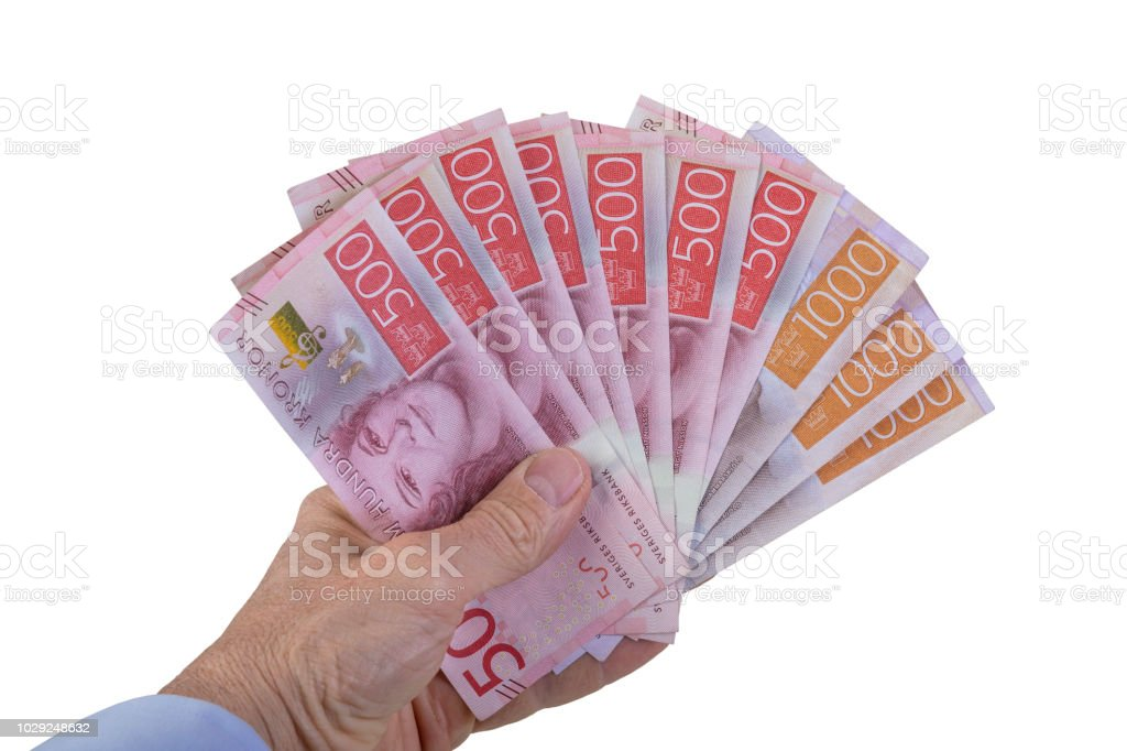Holding five hundred and thousand swedish currency bills stock photo