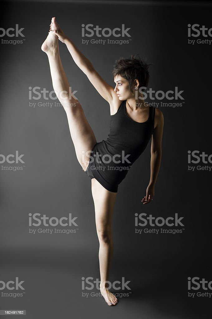 Holding Foot and Stretching royalty-free stock photo