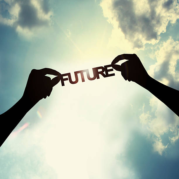 Holding future in sky stock photo
