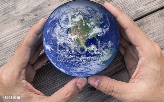 istock holding global in hands , Elements of image furnished by NASA 481931048