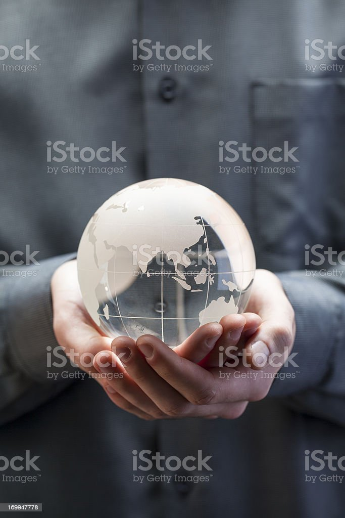 Holding globe - Asia stock photo