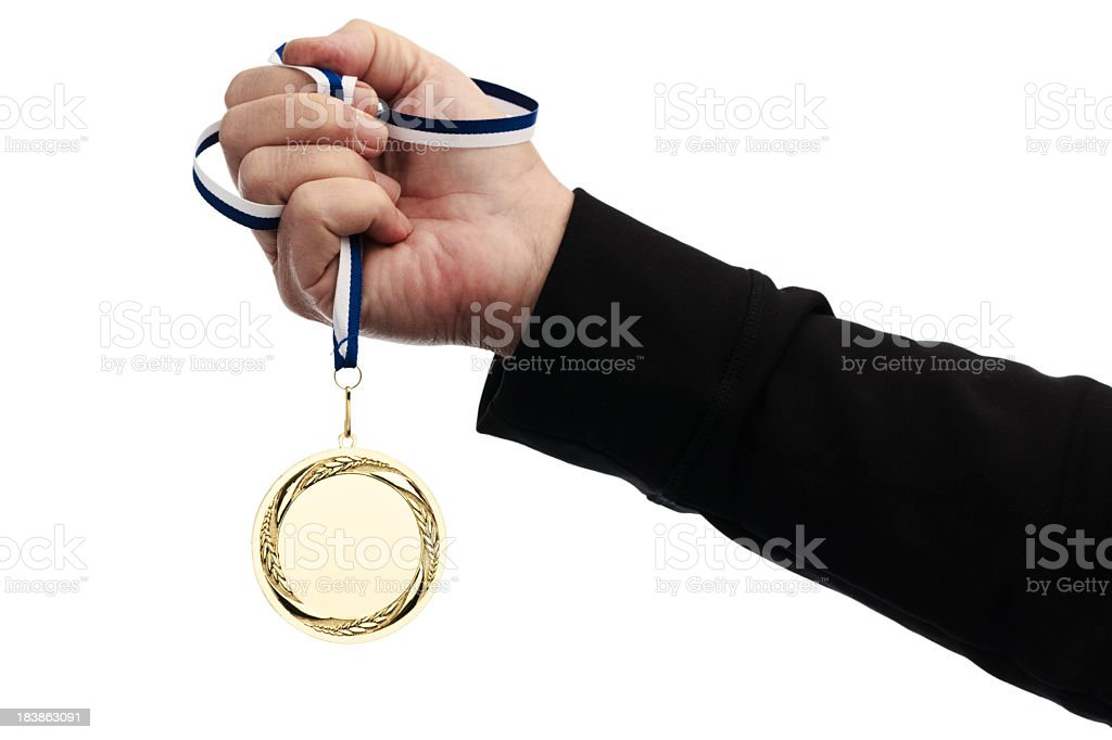 holding gold medal royalty-free stock photo