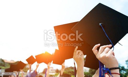 istock holding graduation hats 652225774