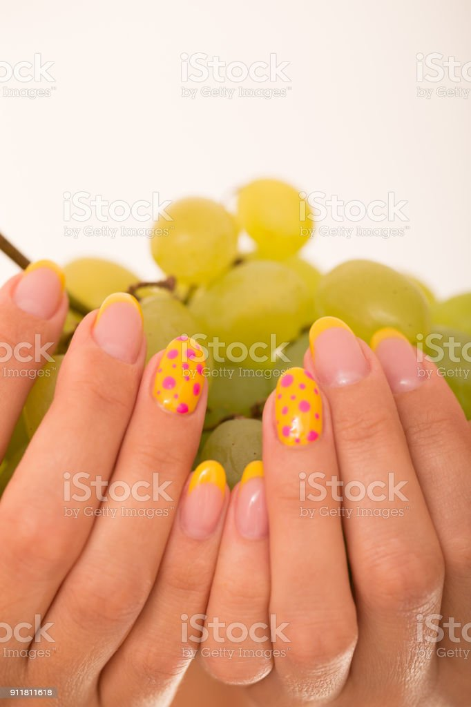 Holding Grape Bunch with Both Hands Close-Up, Nails Polished