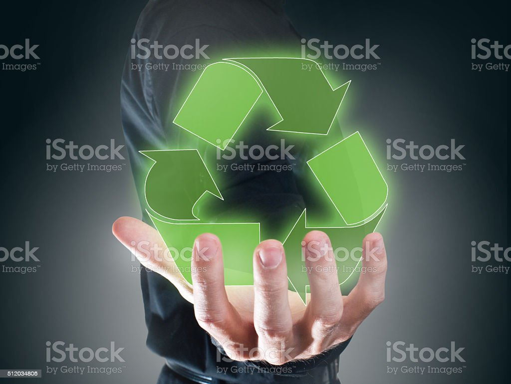 Holding green recycling icon/ Touch screen concept (Click for more) stock photo