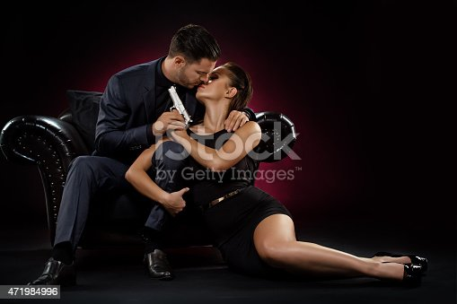 471947536 istock photo holding gun couple kisses 471984996