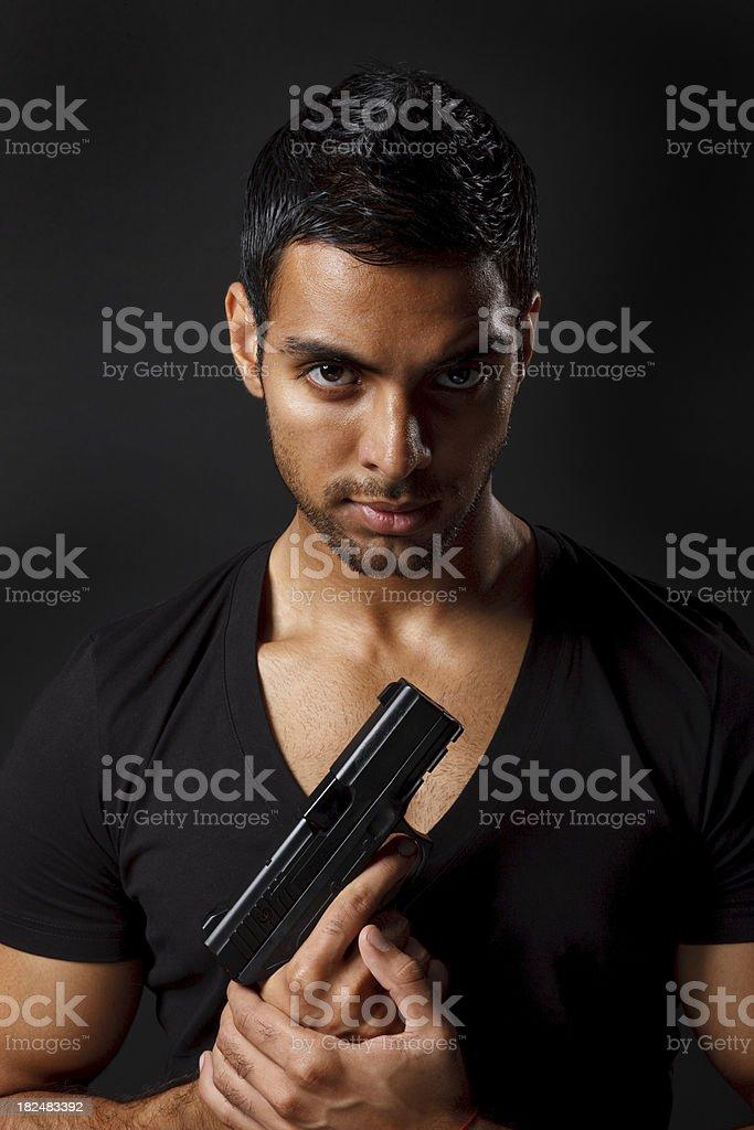 Holding gun royalty-free stock photo