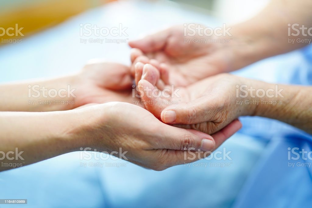 Holding hand Asian senior or elderly old lady patient with love,...