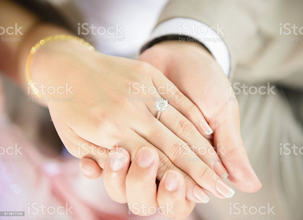 Holding hand stock photo