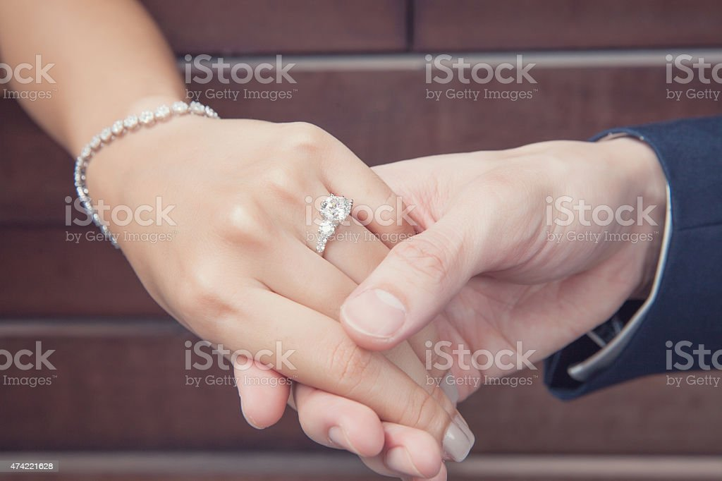 holding hand with diamond ring stock photo