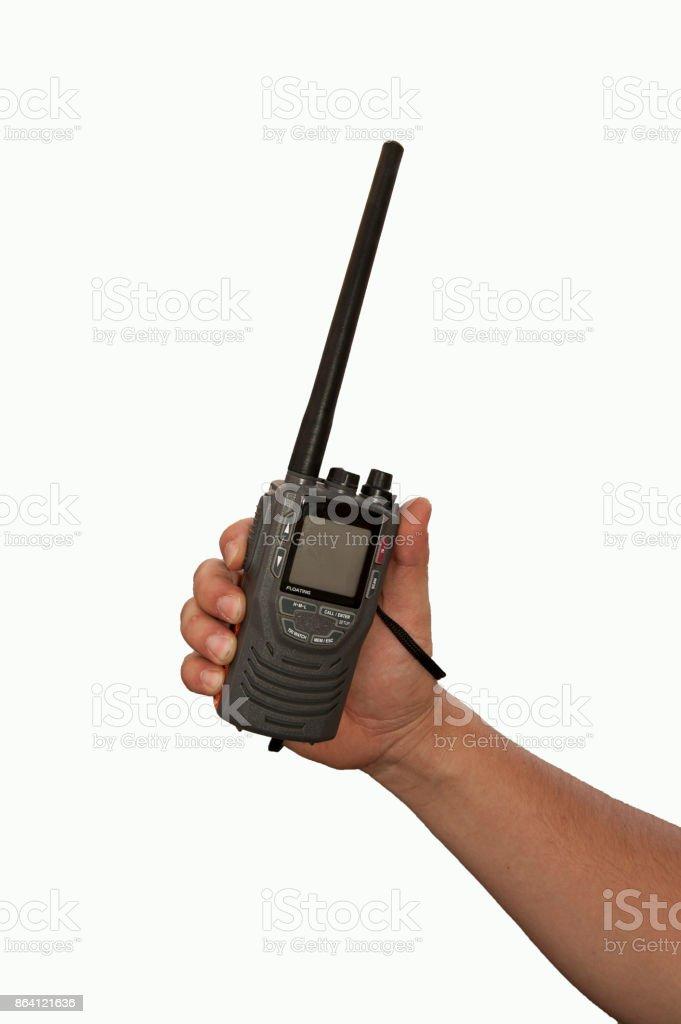 Holding handheld marine VHF Radio royalty-free stock photo