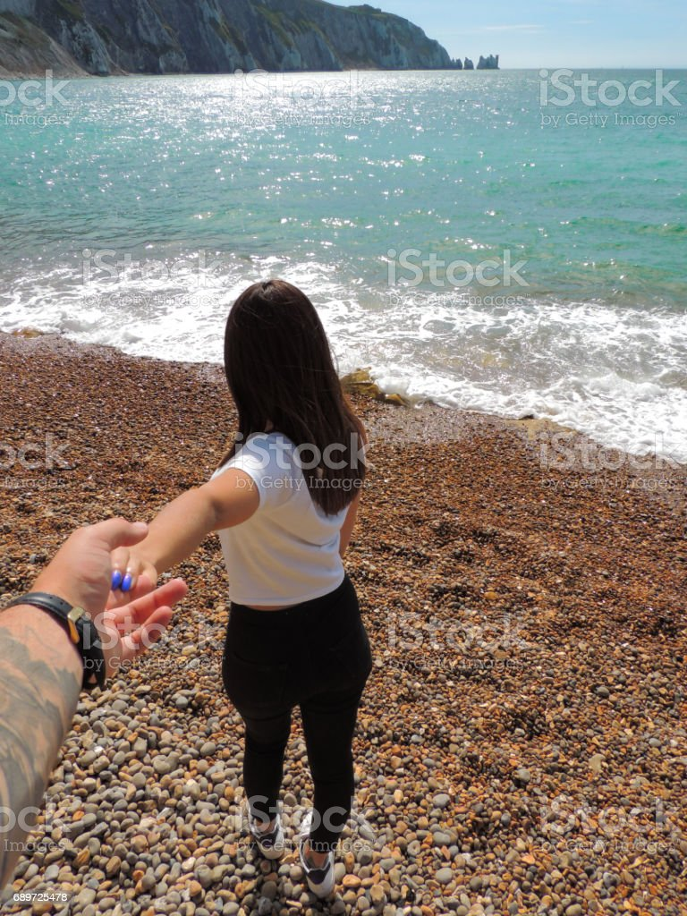 Holding Hands at Alum Bay stock photo