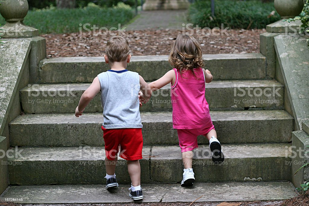 Holding Hands Climbing Stairs royalty-free stock photo