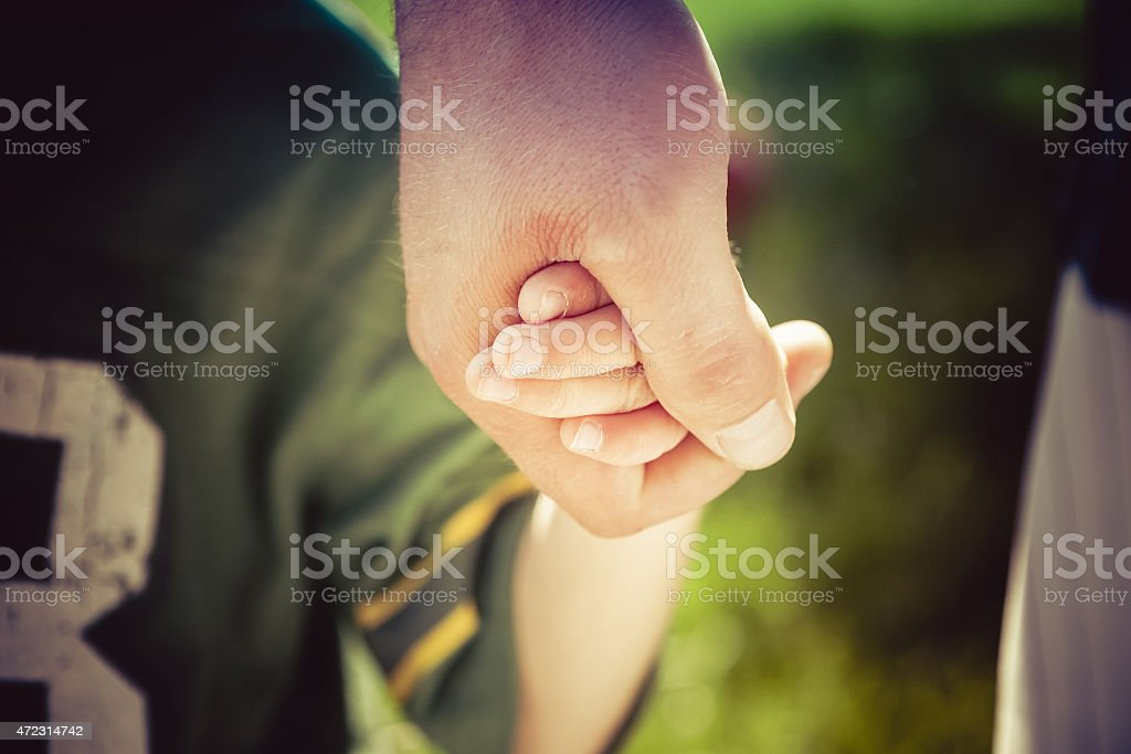 Holding hands - Father and little boy son stock photo