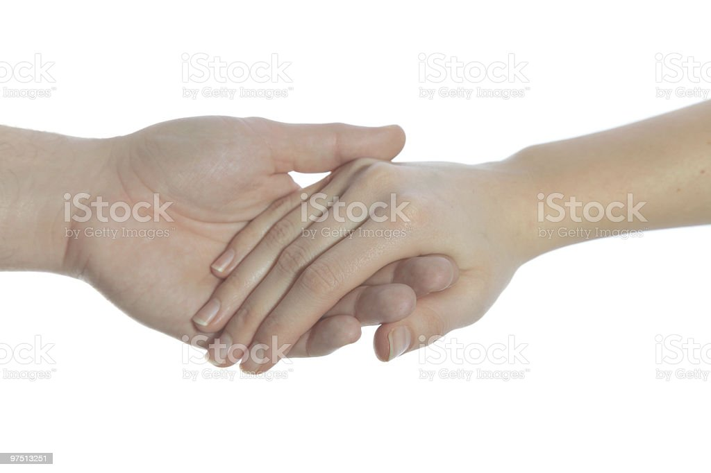 Holding hands in front of a white background royalty-free stock photo