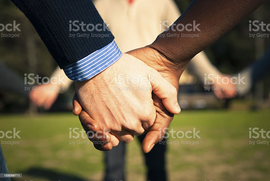 Holding hands, multiracial couple in love royalty-free stock photo