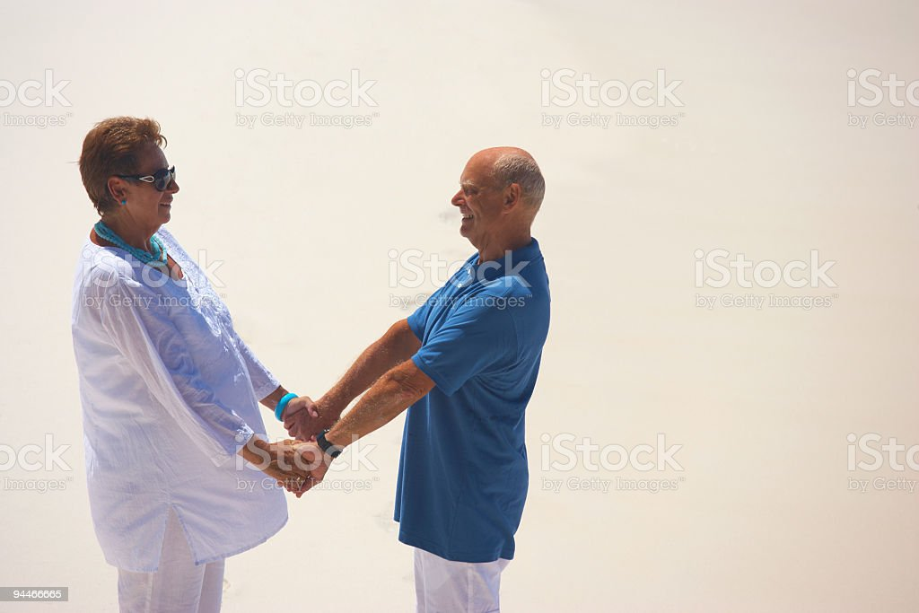 holding hands on the beach royalty-free stock photo