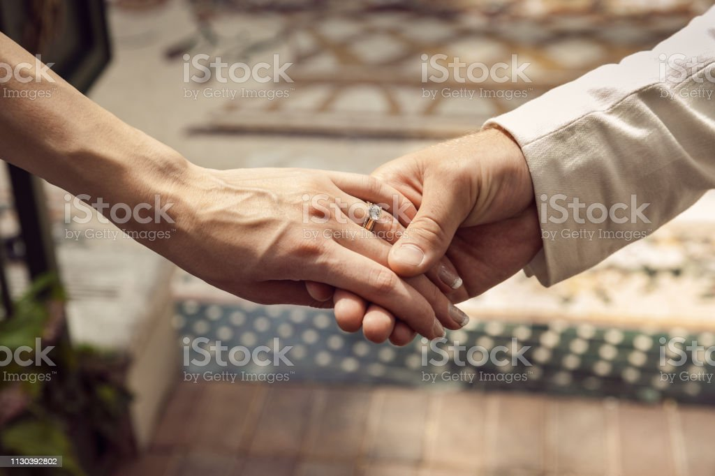 Holding Hands On Wedding Day stock photo