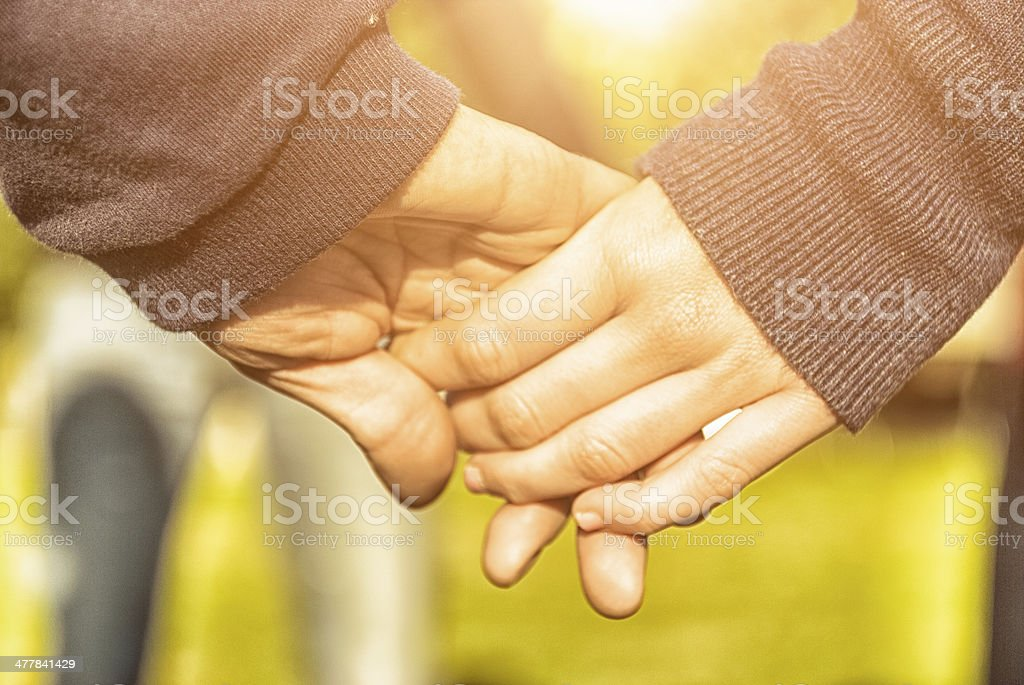 Holding hands - teenagers royalty-free stock photo