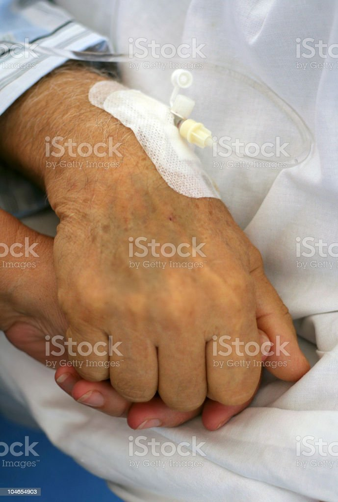 Holding hands with an old person at a hospital stock photo