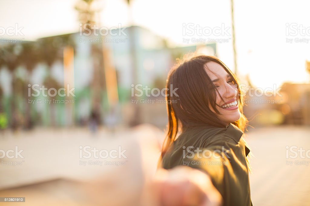 Holding hands with her girlfriend. stock photo