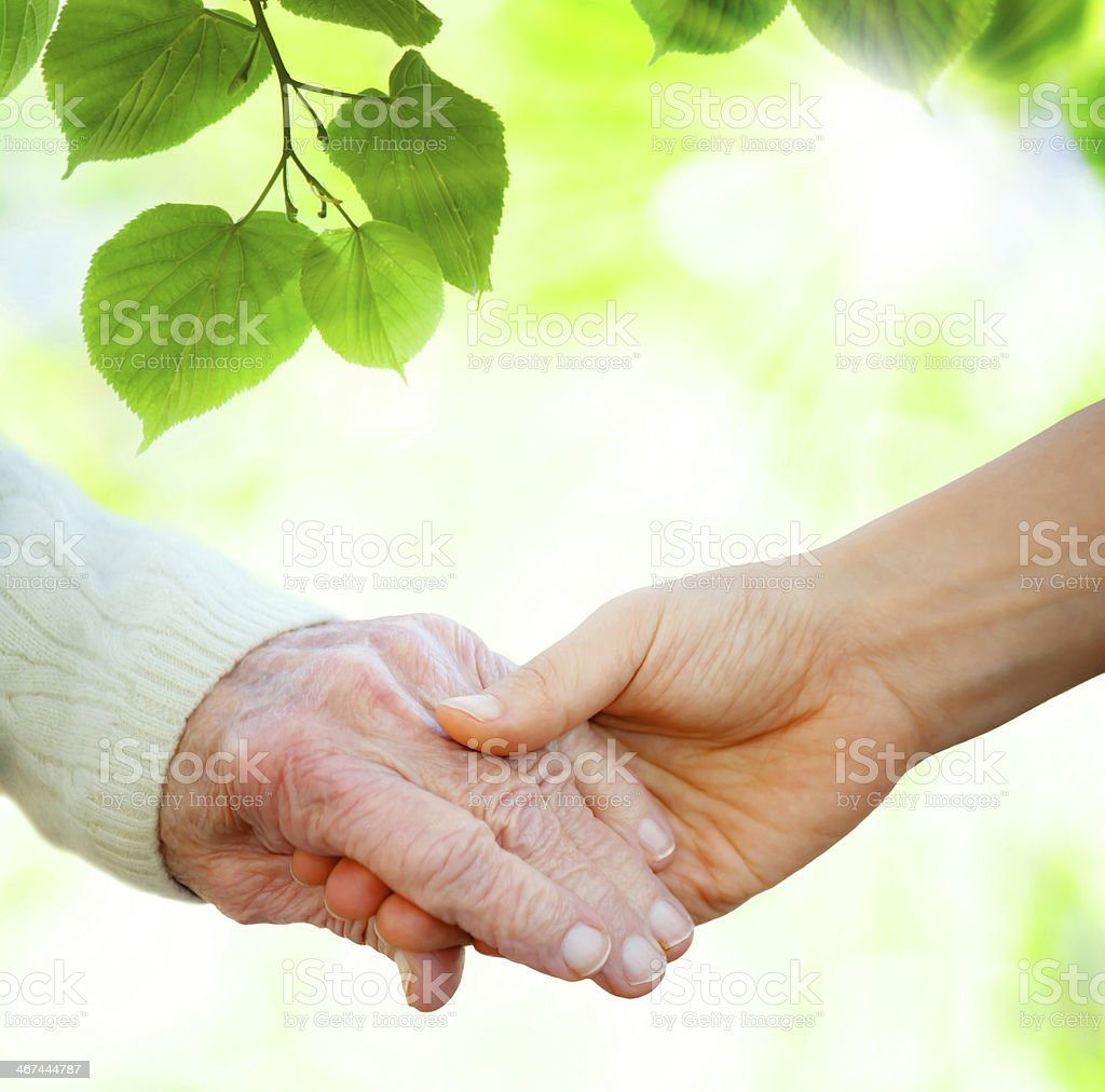Holding hands with senior stock photo