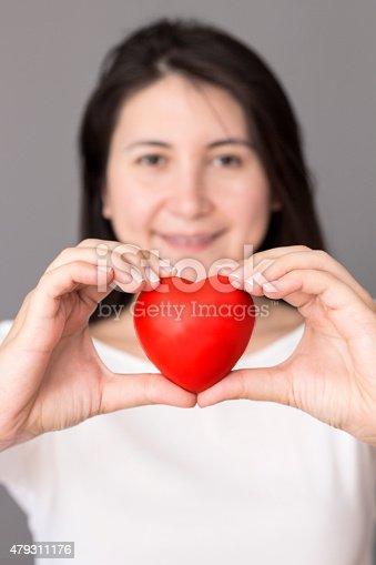 1035479448 istock photo Holding Heart 479311176